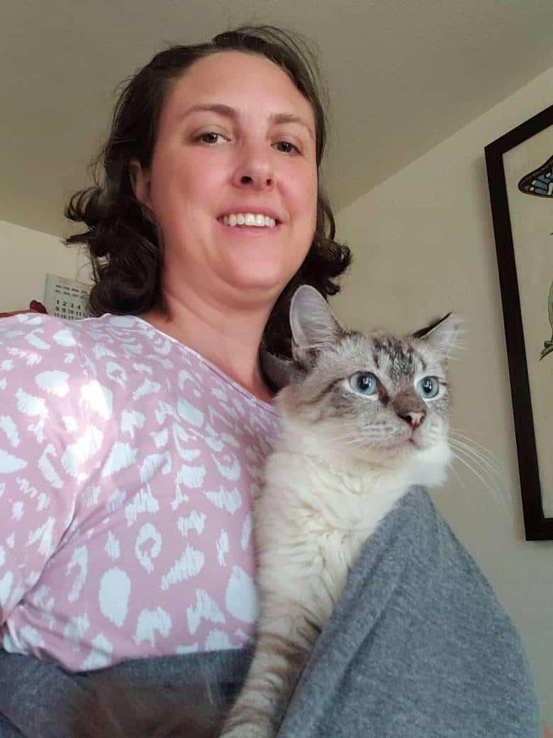 Melissa wearing her Siamese kitten.